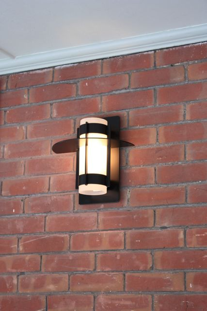 wall mount comet sconce exterior